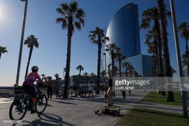 People exercice at the Barceloneta beach in Barcelona on May 20, 2020 during the hours allowed by the government to exercise, amid the national...