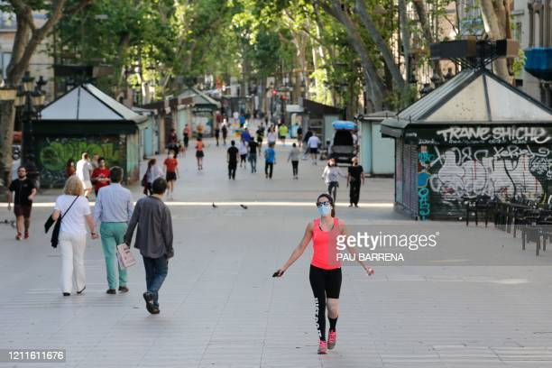 People exercise along Las Ramblas in Barcelona, on May 2 during the hours allowed by the government to exercise, for the first time since the...