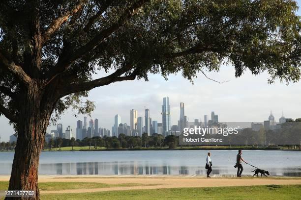People exercise at Albert Park Lake on September 09, 2020 in Melbourne, Australia. Metropolitan Melbourne remains under stage 4 lockdown...