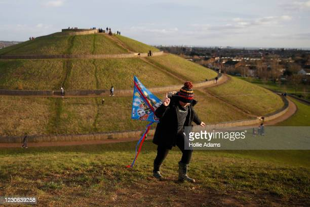 People exercise at Northala Fields on January 17, 2021 in London, United Kingdom. With a surge of covid-19 cases fueled partly by a more infectious...