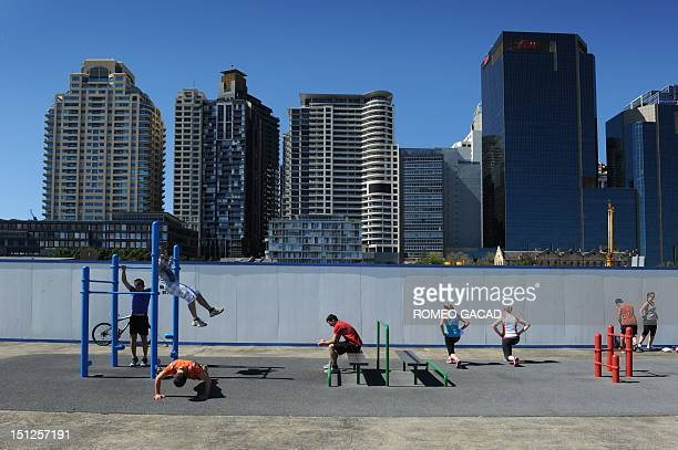 People exercise at Sydney's Darling Harbour on September 5 2012 Australia's miningpowered economy grew a solid 06 percent in the three months to June...