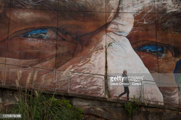 People exercise during self isolation in Balmain on March 26, 2020 in Sydney, Australia. Further restrictions on travel and movement have been put in...