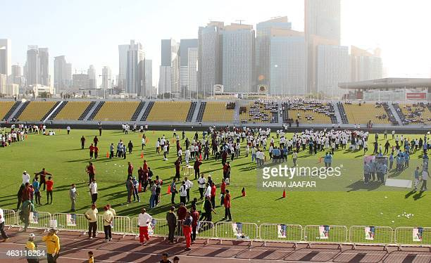 People exercise during the Qatar National Sport Day in the capital Doha on February 10 2015 More than a million Qataris were given a day off work to...