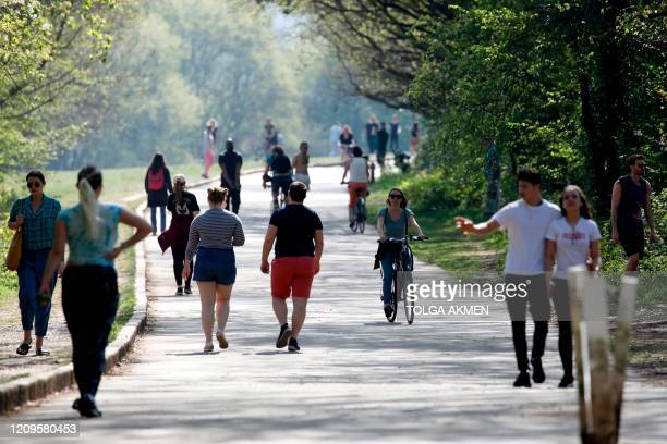 People exercise in Alexandra Park in north London on April 10, 2020 as warm weather tests the nationwide lockdown and the long Easter weekend begins....