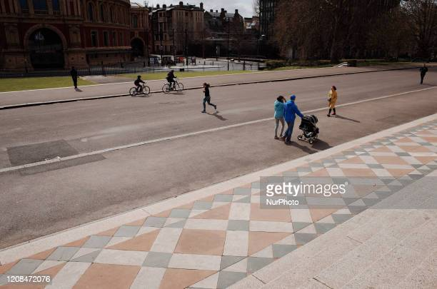 People exercise in front of the Albert Memorial across from the Royal Albert Hall in Kensington Gardens in London England on March 28 2020 The UK is...