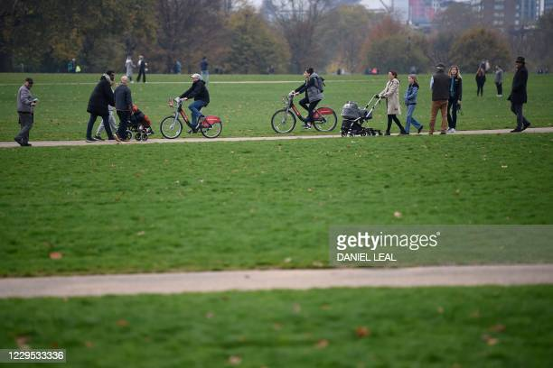 People exercise in Hyde Park in central London on November 8, 2020 during a second national lockdown designed to contain soaring infections of the...