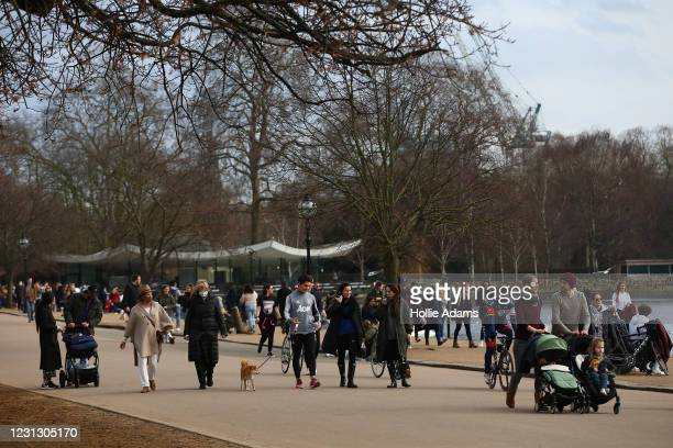 People exercise in Hyde Park on February 21, 2021 in London, England. The British government is expected to announce tomorrow its plans for easing...