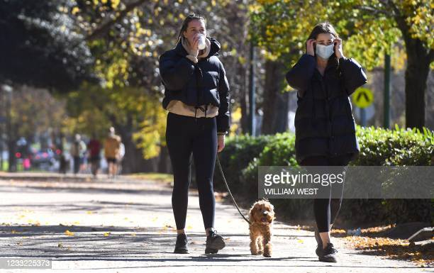 People exercise in Melbourne on June 2, 2021 with the coronavirus lockdown of Australia's second-biggest city to be extended by another seven days,...