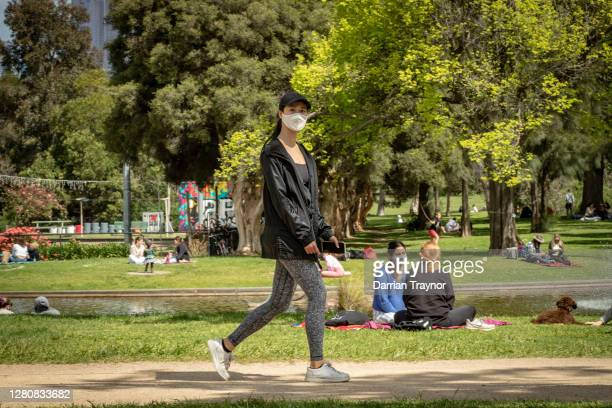 People exercise in Princes Park on October 18 2020 in Melbourne Australia Victoria recorded two new COVID19 cases and no deaths overnight Victorian...