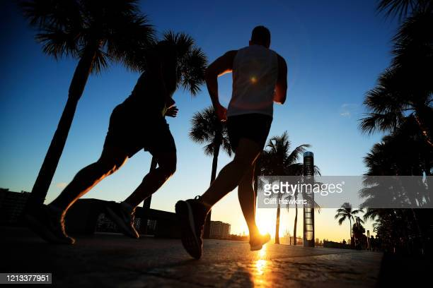People exercise in South Pointe Park on March 18 2020 in Miami Beach Florida Miami Beach city officials closed the area of the beach that is popular...