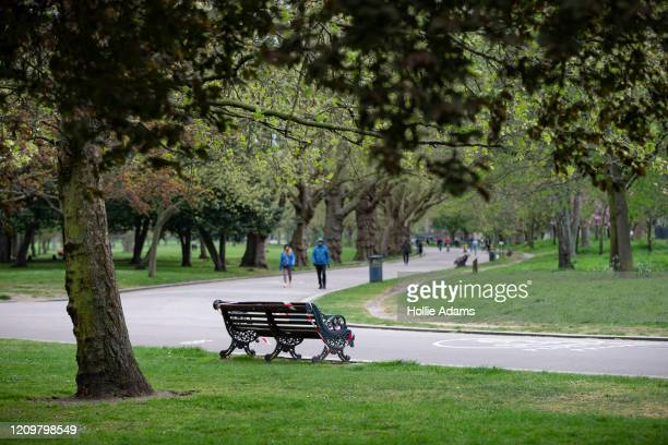 People exercise in Victoria Park on April 13, 2020 in London, United Kingdom. The Coronavirus pandemic has spread to many countries across the world,...