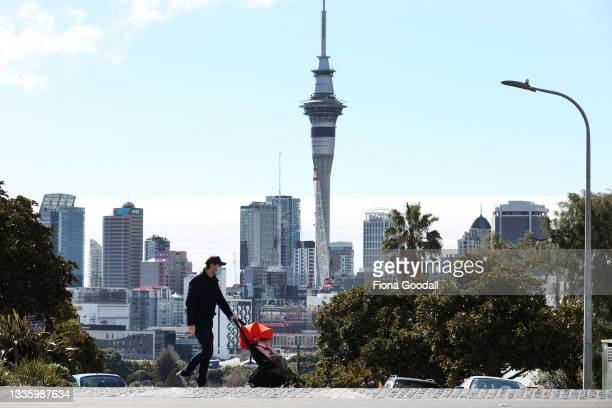 People exercise on Ponsonby Rd on August 24, 2021 in Auckland, New Zealand. Level 4 lockdown restrictions are in place across New Zealand as new...