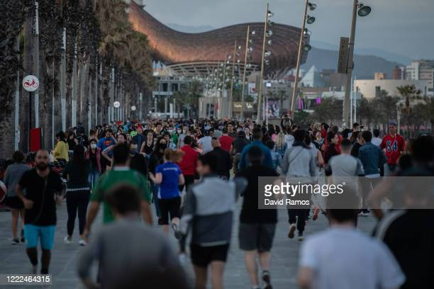 People exercise outdoor at sunset at La Barceloneta Beach on May 02, 2020 in Barcelona, Spain. Spain continues to ease the Covid-19 lockdown measures...