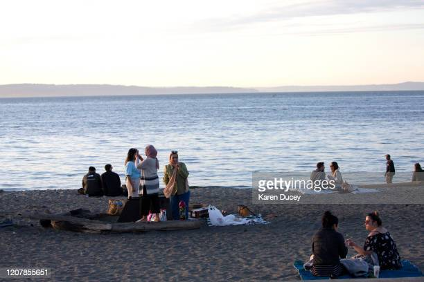 People exercise social distancing at Alki Beach Park on March 20 2020 in Seattle Washington Washington Governor Jay Inslee strongly encourages people...