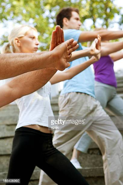 People Exercise Tai Chi Outdoor - Closeup of Hands