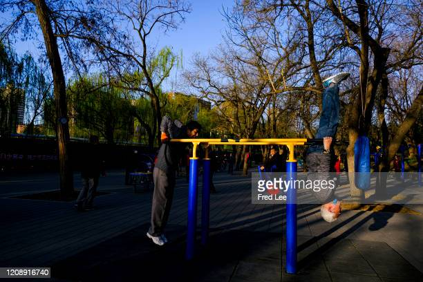 People exercise while wearing a masks as part of precautionary measures against the spread of the COVID19 on April 02 2020 in Beijing China Health...