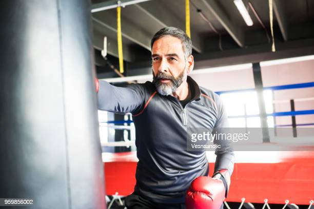people exercising at gym - boxing sport stock pictures, royalty-free photos & images