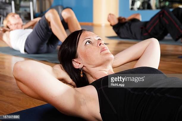 people exercising in a fitness class - rich_legg stock pictures, royalty-free photos & images