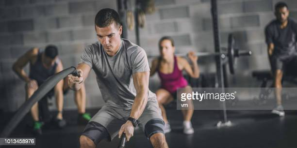 people exercising in a gym - man made object stock pictures, royalty-free photos & images