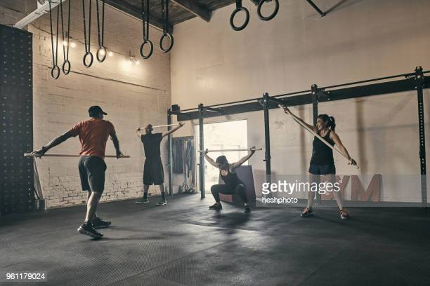people exercising in gym - heshphoto stock pictures, royalty-free photos & images