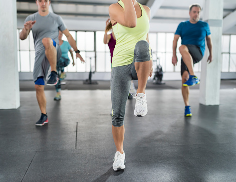 People exercising in gym 992052362