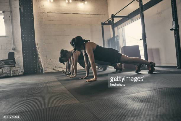 people exercising in gym, push ups - heshphoto stock pictures, royalty-free photos & images