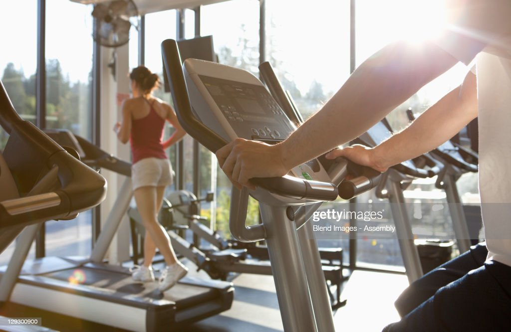 People exercising in health club : Stock Photo