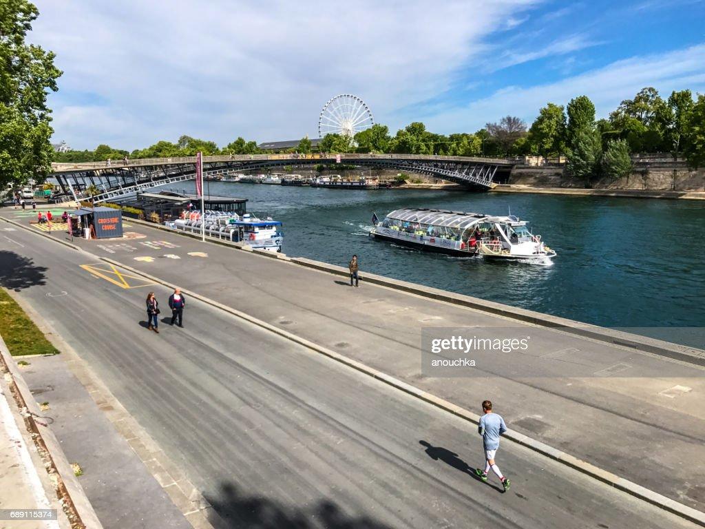 People exercising on Seine embankment, Paris, France : Stock Photo