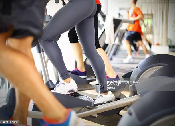People exercising on treadmills.
