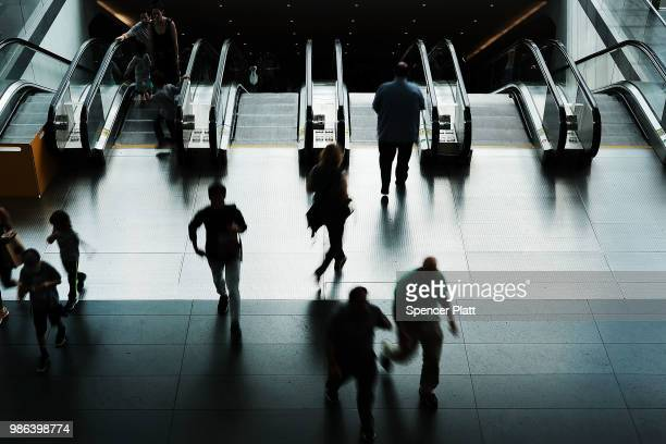 People exit a subway into a Manhattan shopping mall on June 28 2018 in New York City The American economy showed the weakest performance in consumer...