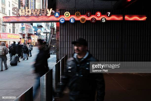 People exit a subway station on January 10 2018 in New York City The New York City subway system which opened in 1904 and is the world's largest...