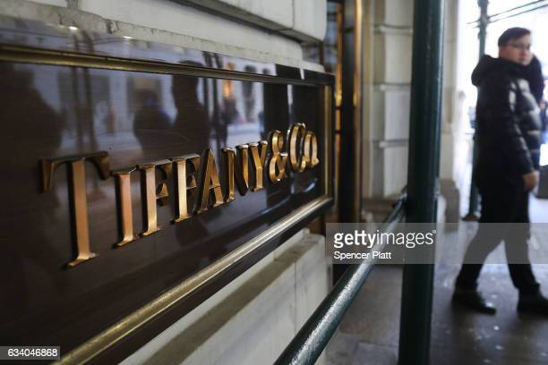 People exit a Tiffany Co store in lower Manhattan on February 6 2017 in New York City Following disappointing financial resultsTiffany Co abruptly...