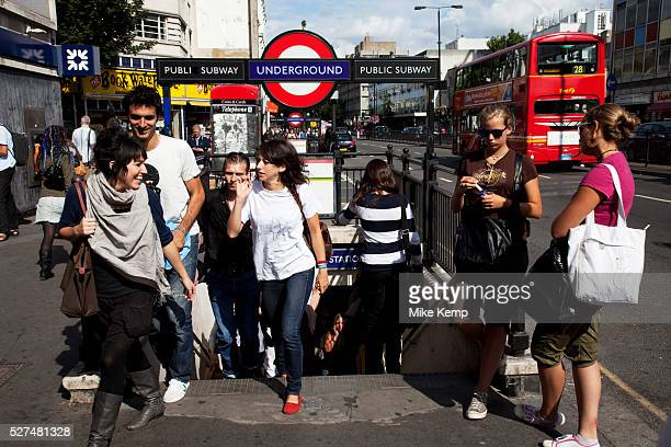 People exit Notting Hill Gate underground station West London made famous by the movie Notting Hill