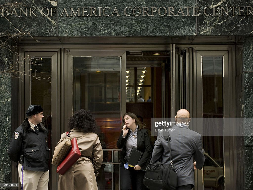 People exit the Bank of America headquarters on February 4, 2010 in Charlotte, North Carolina. Bank of America's former Chief Executive Officer Ken Lewis and former Chief Financial Officer Joe Price have been charged with securities fraud by the New York attorney general.