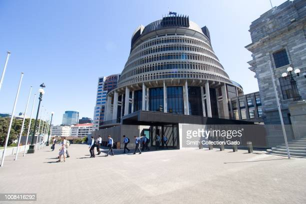 """People exit the """"Beehive"""" building at the New Zealand Parliament on Lambton Quay in downtown Wellington, New Zealand, November 28, 2017."""