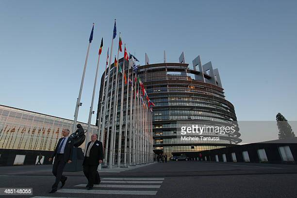 People exit the building of the European Parliament on the riverside of the Ill river on April 16 2014 in Strasbourg France This week's EU plenary...