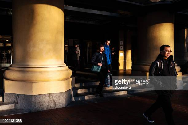 People exit the Wellington Railway Station in Wellington New Zealand on Wednesday July 18 2018 New Zealand inflation picked up in the second quarter...