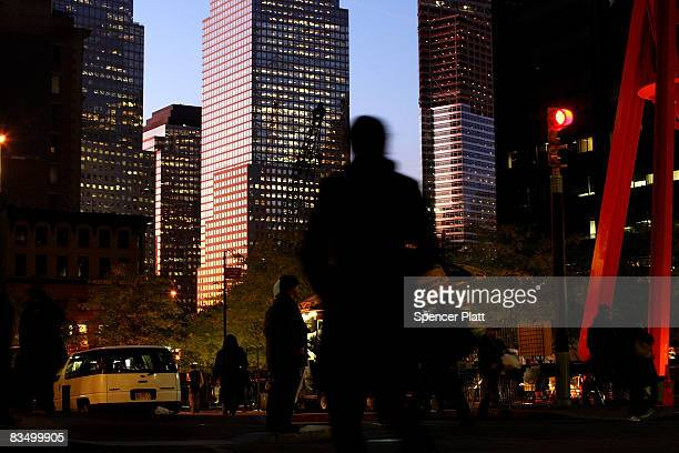People exit work in the financial district October 30 2008 in New York City The American economy shrank 03 per cent during the third quarter it was...