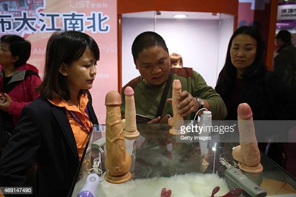 People experience adult toys during the 2015 China International Adult Toys and Reproductive Health Exhibition at Shanghai Convention Exhibition...