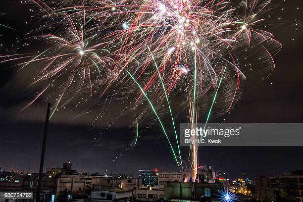 People explode fireworks during the New Year countdown celebrations on January 1 2017 in Taipei Taiwan