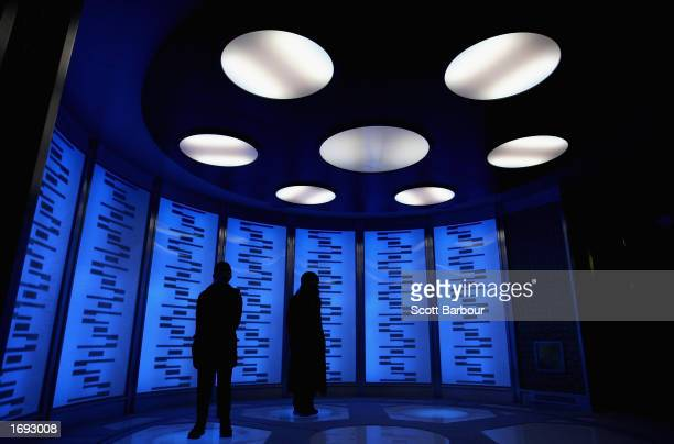 People explore the 'Transporter Room' exhibit at the 'Star Trek The Adventure' exhibition December 18 2002 in London England The public exhibition is...