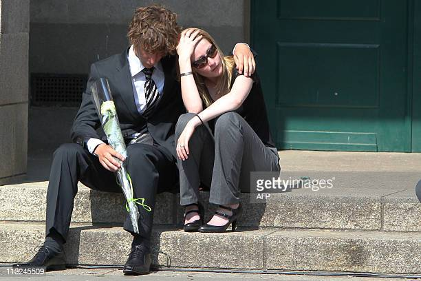 People express their grief during the funeral ceremony of the Dupont de Ligonnes family on April 28 2011 in the French western city of Nantes Five...