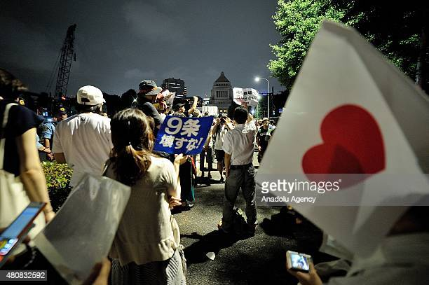 People express their opposition during an emergency action against the change of the Japan Pacifist constitution and demanding the retraction of the...