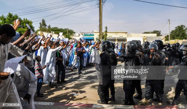 People face antiriot police officers as they demonstrate on November 10 2017 in Nouakchott against a justice ruling after Mauritanian prosecutors...
