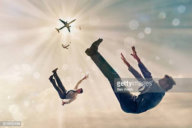 people falling from airplane - airplane crash stock pictures, royalty-free photos & images