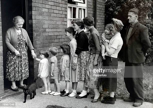 September 1958 Bolton England Mr and Mrs Stanton with their 7 children at the doorstep of the children's grandmother as they pay a visit