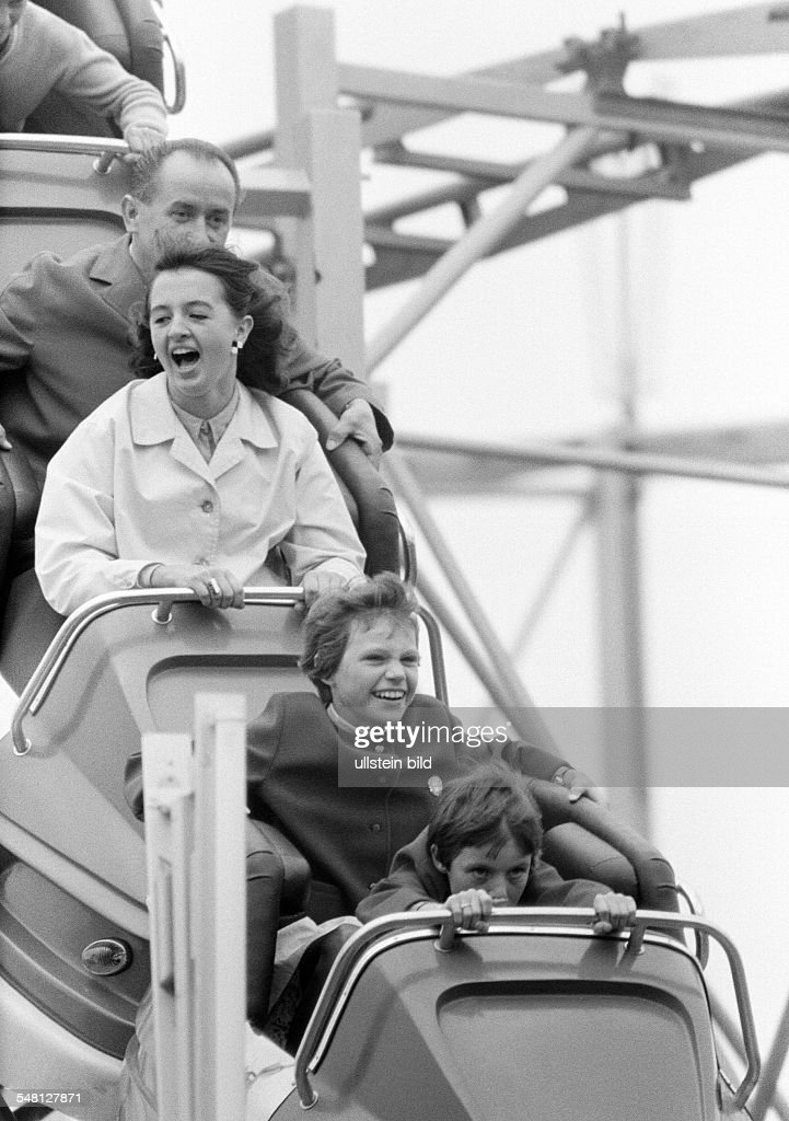 people, family on the kermess, Munich Beer Festival 1966, fun with a roller coaster ride, man, aged 35 to 40 years, woman, aged 30 to 35 years, girl, aged 11 to 14 years, boy, aged 8 to 11 years, D-Munich, Isar, Upper Bavaria, Bavaria - 30.09.1966 : News Photo