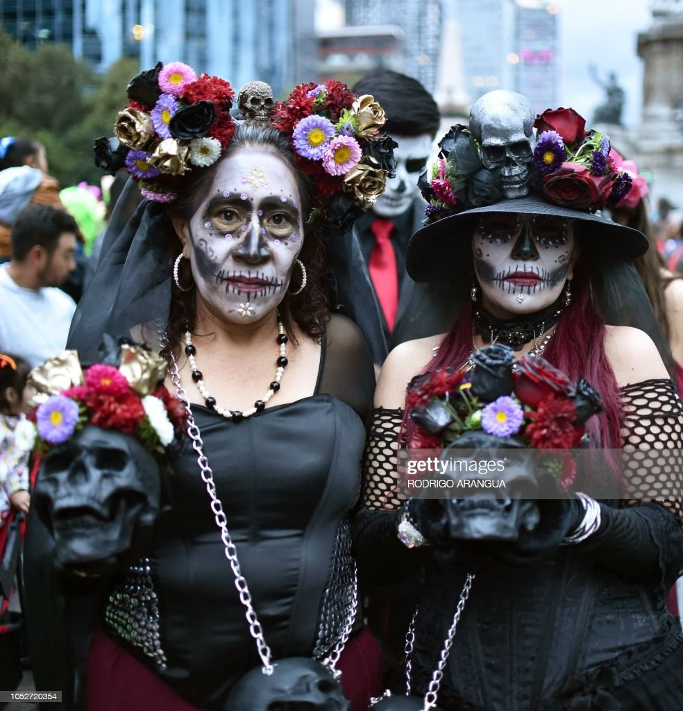 People Fancy Dressed As Catrina Take Part In The Catrinas Parade