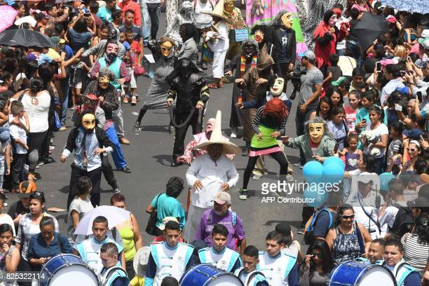 People fancy dressed as mythological characters take part in a parade marking the start of San Salvador's patron saint's festival in honor of Divino...