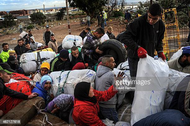 People fight for the position as they wait to cross the 'Barrio Chino' border crossing point between Melilla and Morocco on January 20 2015 in...